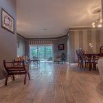 Wood-Look Tile Flooring in the living room from hallway