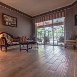 Wood-Look Tile Flooring Family Room Overlooking Pool