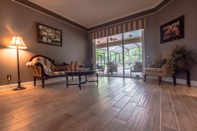 Wood-Look Tile Flooring Family Room Overlooking Pool