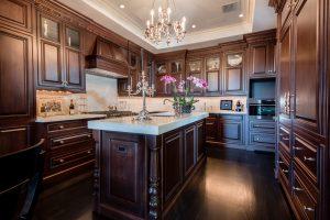 Custom Black Oak Flooring with white granite in Kitchen