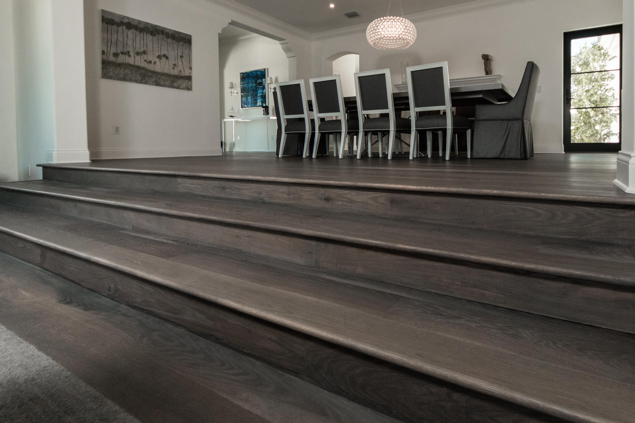 Custom Grey Oak Flooring In Dining Room with Steps