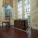 Copaiba Lava Wood Flooring in Dining Room with Chest