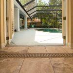 Copaiba Lava & Porcelain Flooring Looking Over Pool
