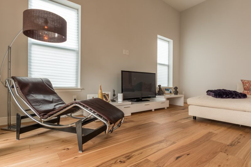 Wire-Brushed Natural Hickory Wood Flooring in Living Room with Modern Looking Chair