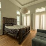 Wire-Brushed Natural Hickory Wood Flooring in Bedroom with Curtains Drawn