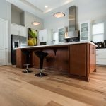 Wire-Brushed Natural Hickory Wood Flooring in Kitchen with Black Retro Stools