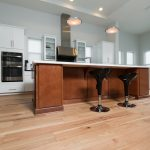 Wire-Brushed Natural Hickory Wood Flooring in Kitchen with Stainless Steel Fridge
