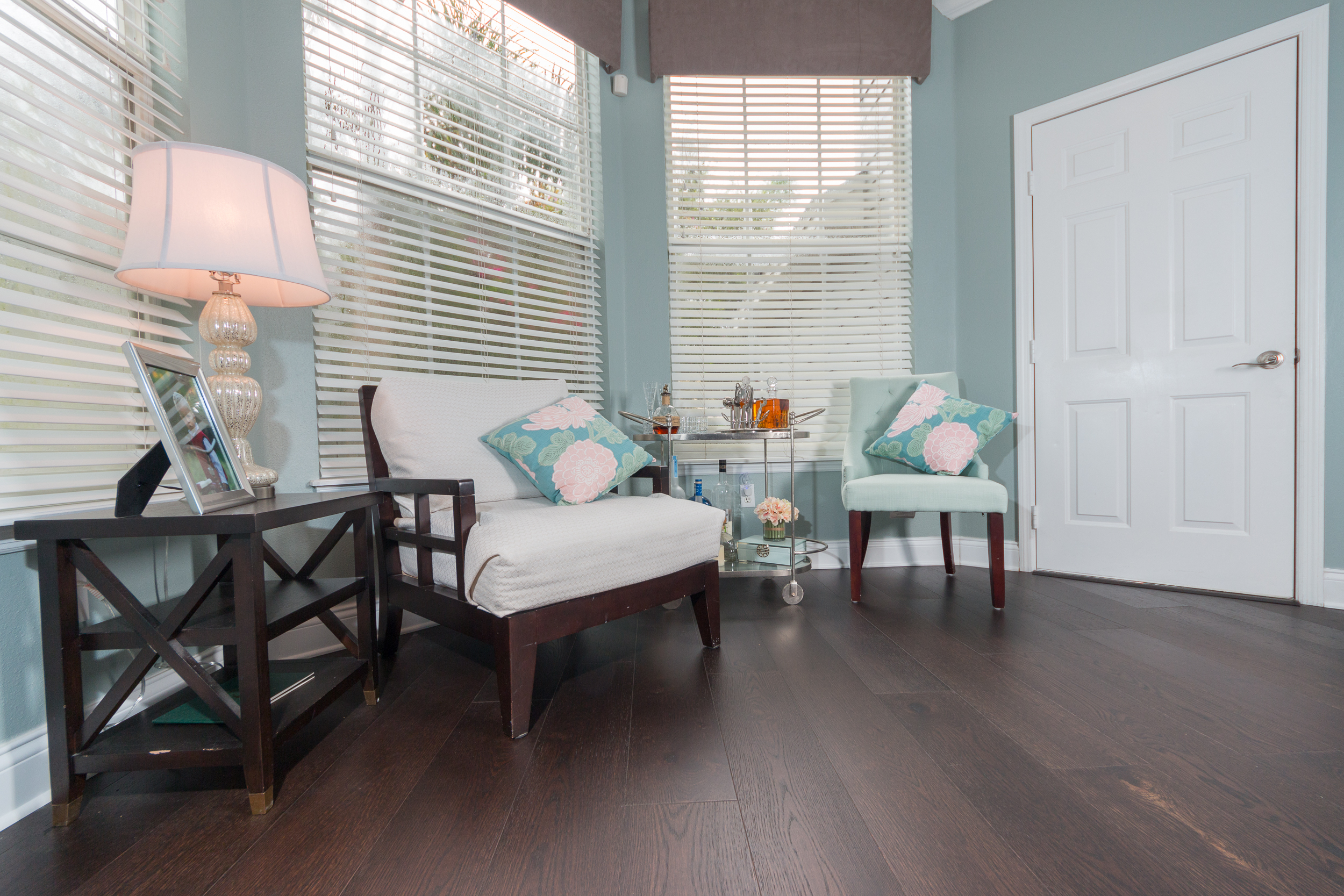 Mellow Oak Wood Flooring with teal walls