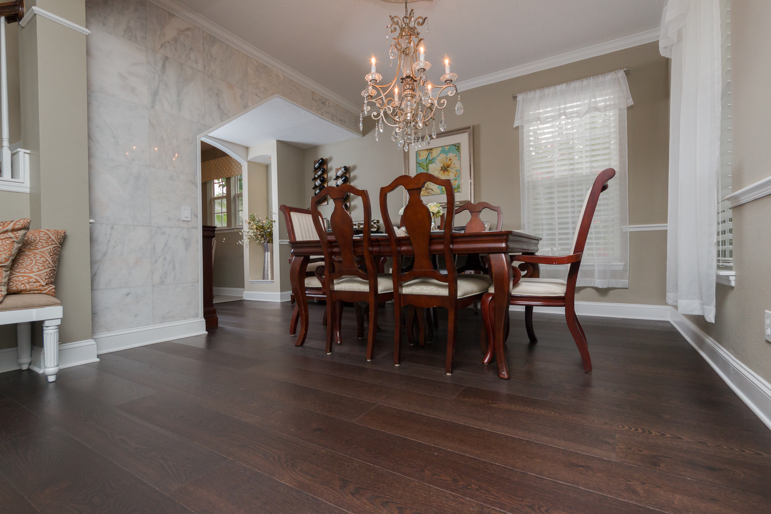 Mellow Oak Wood Flooring with Tile in Dining Room with marble walls