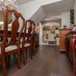 Mellow Oak Wood Flooring with Tile in Dining Room with cherry wood furniture