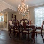 Mellow Oak Wood Flooring Dining Room with white curtains