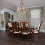 Mellow Oak Wood Flooring with Tile in Dining Room with crystal chandelier