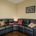 Spanish Hickory Blackhills Wood Flooring in Living Room black couch