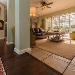 Brown Distressd Birch Wood Flooring in Hall overlooking living room