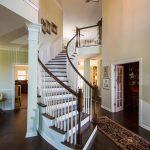 Brown Distressd Birch Wood Flooring in Stairway with chandelier