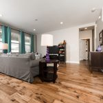 Champagne Hickory Wood Flooring in Living Room with teal curtains