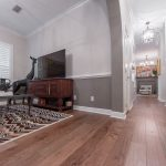 Wire-Brushed Brown Hickory flooring entertainment room and hallway view