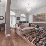 Wire-Brushed Brown Hickory flooring entertainment room and entry