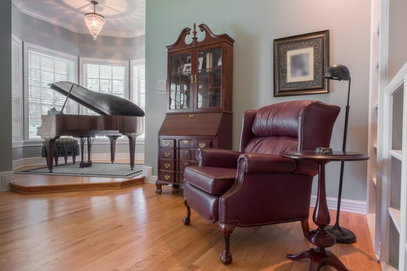 Natural Solid Oak flooring piano and sitting room