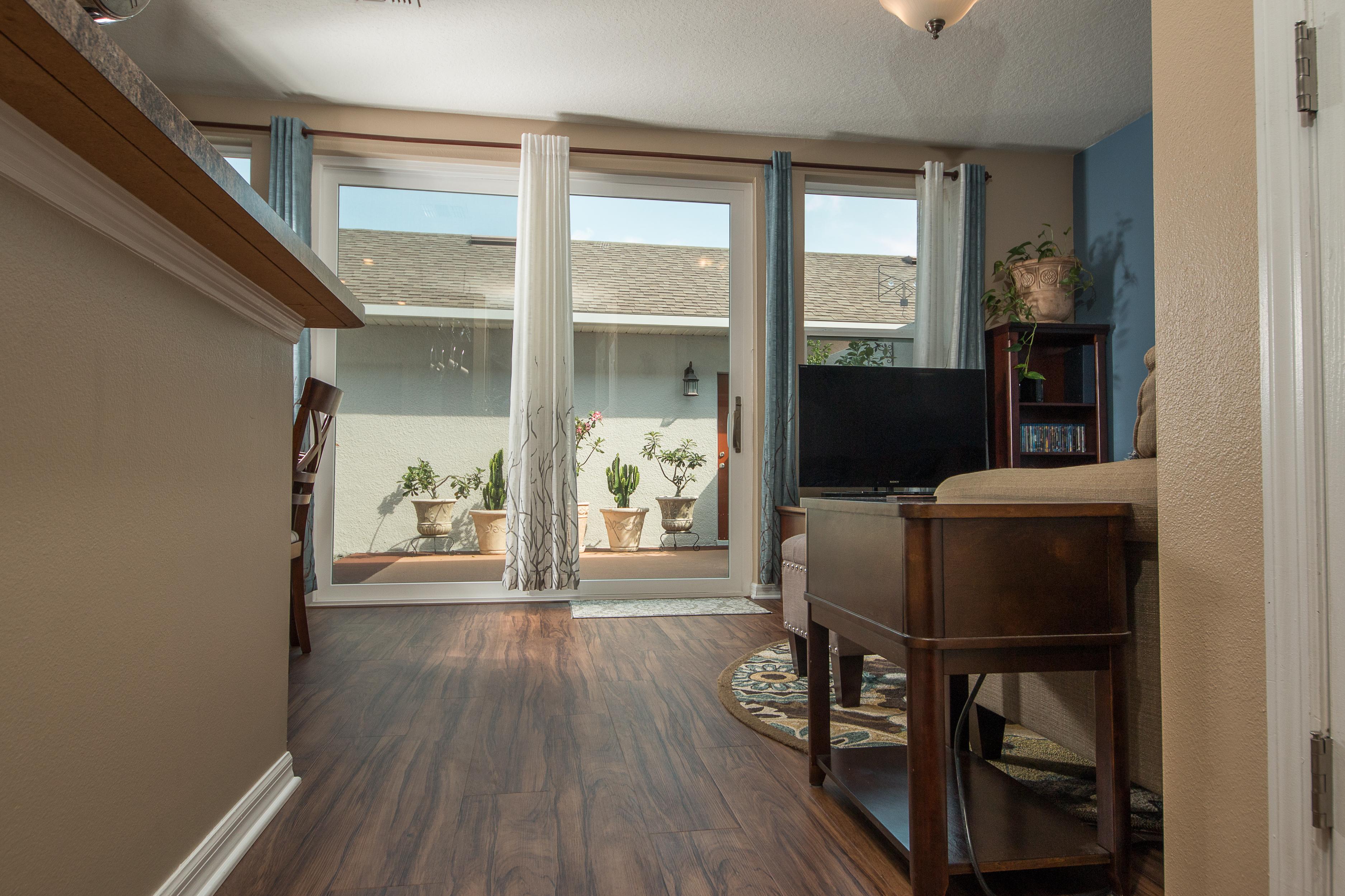 PVC Vinyl & Gray Carpet flooring kitchen, breakfast nook and sitting room
