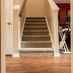 PVC Vinyl & Gray Carpet flooring stairwell, hallway and workout area