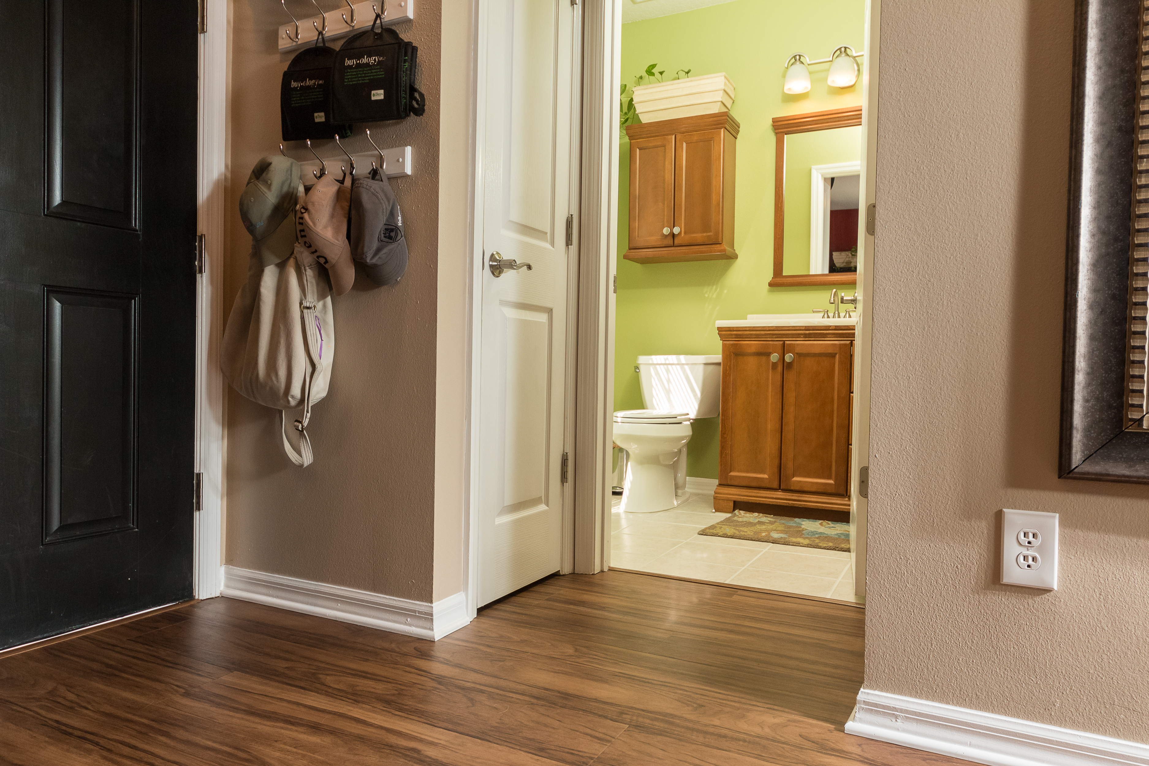 PVC Vinyl & Gray Carpet flooring half bath and hallway